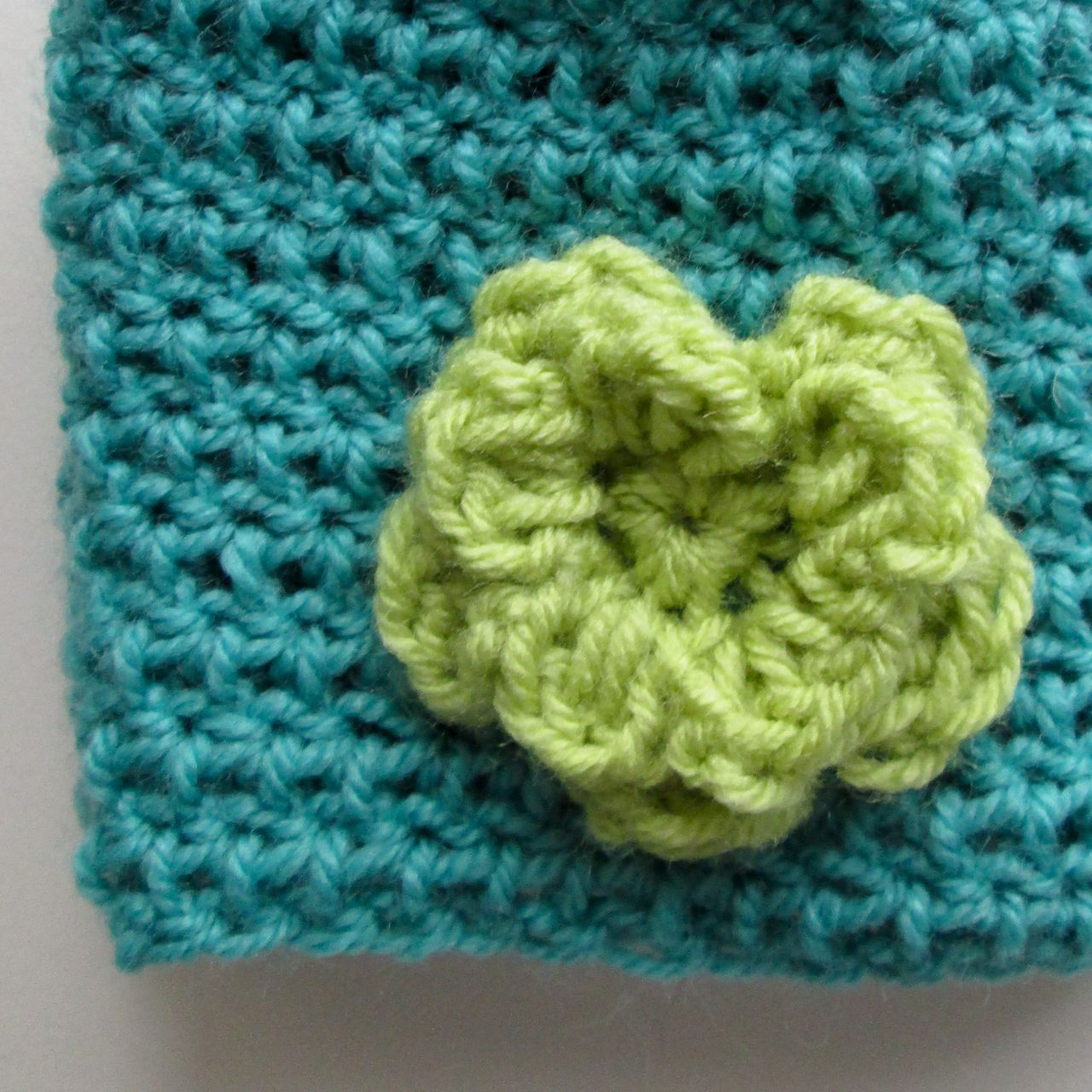 green crochet flower
